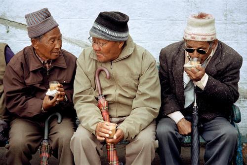 Old locals enjoying some gossip in Chowrasta square, Darjeeling, West Bengal.
