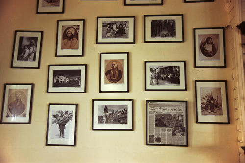 Photographs in Glenary's restaurant on the Mall, Darjeeling, West Bengal.