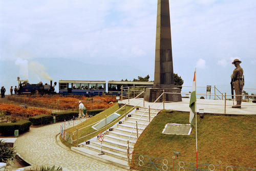 The Darjeeling Toy train parked at the War Memorial located at the center of the Batasia Loop garden in Darjeeling, West Bengal.