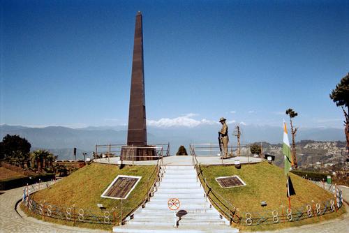 The War Memorial located at the center of the Batasia Loop garden in Darjeeling, West Bengal.