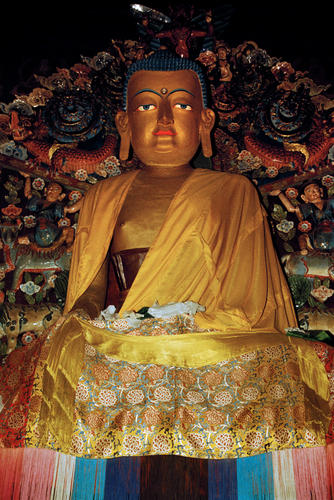 The major attraction of the Samten Choling Monastery is the 26 foot model of Lord Buddha. Ghoom, West Bengal.