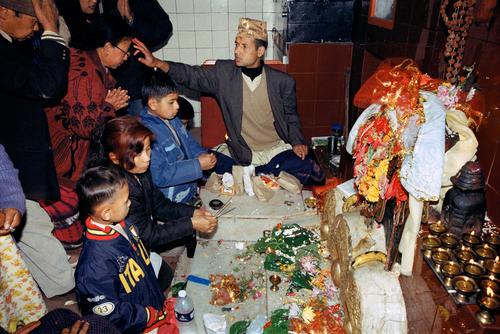 Devotees praying in the Mahakal Mandir Hindu temple on top of the Obseratory Hill in Darjeeling, West Bengal.
