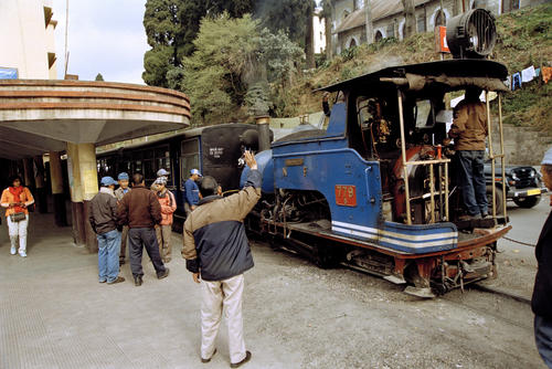 The Darjeeling Himalayan Railway (also known as the DHR or 'Toy Train') being flagged off at Darjeeling station, West Bengal.