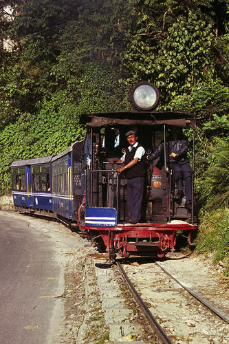 The Darjeeling Himalayan Railway (also known as the DHR or 'Toy Train') chugging its way from Darjeeling to Ghoom, West Bengal.
