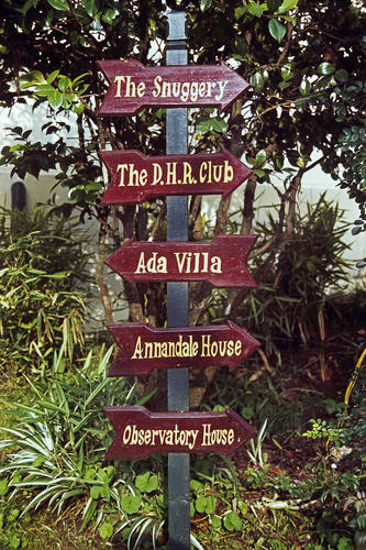 A signpost at the Windamere Hotel, Darjeeling, West Bengal.