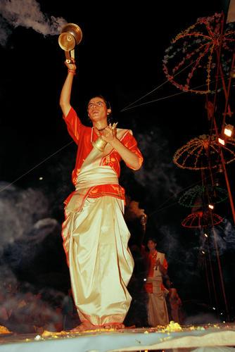 Devotees performing at a daily Hindu Aarti or worship held on the Dashashwamed ghat, Varanasi, Uttar Pradesh India