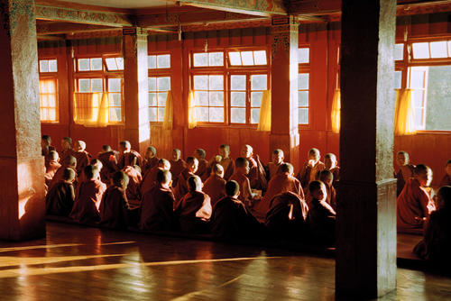 Young monks bathed in afternoon light at the Dali Gompa just one of many monasteries close to Darjeeling in West Bengal.