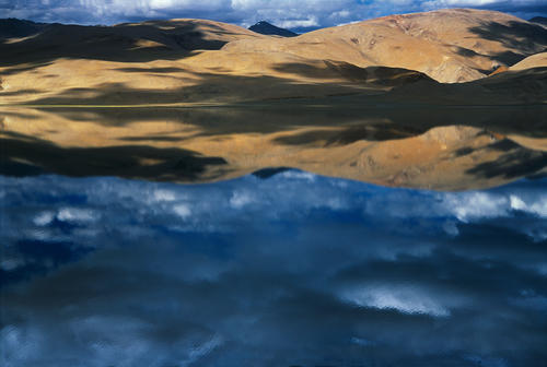 Clouds reflected in Lake Tso-Moriri, Korzok, Ladakh.