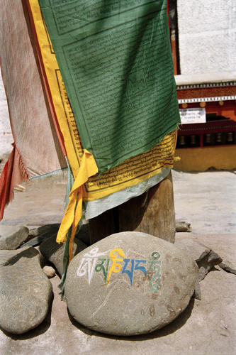 Mani stones and prayer flags at the Likir temple. Ladakh.