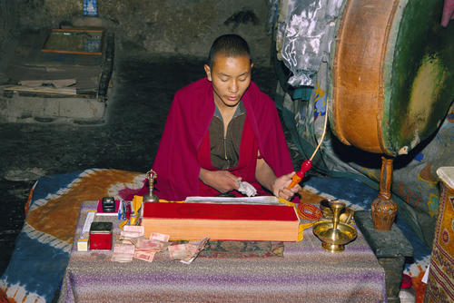Young monk performing a mantra at the Basgo temple, Ladakh.