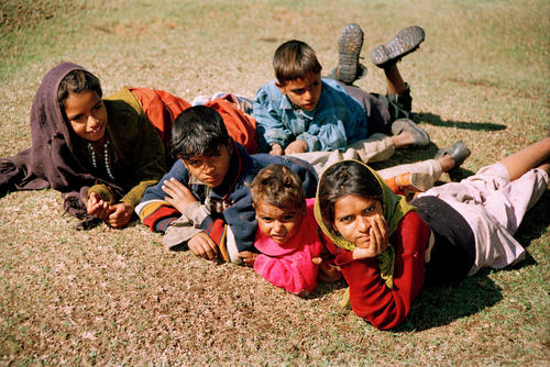 Children laying on a typical Kashmiri meadow, Pahalgam, Kashmir.