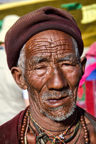 Old gentleman belonging to the Chang Pa indigenous grouping outside the Korzok monastery in Ladakh, India