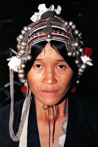 Tribal lady belonging to the Akha indigenous grouping at the market at Muang Sing, Luang Namtha Province, Laos.