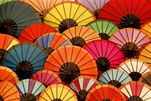 Brightly coloured handmade parasols on sale in the night market, Luang Prabang, Laos.
