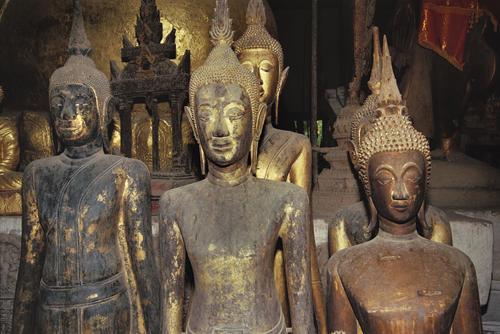 Idols in the Wat Wisunalet temple, Luang Prabang, Laos.