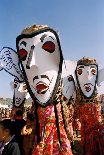 Masked dancers performing in a parade at the annual Elephant Festival held in Sayaboury Province, Laos.