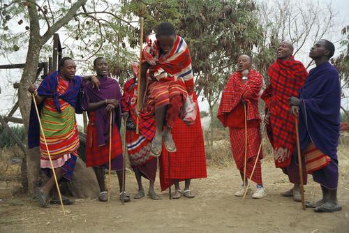 Maasai tribesmen performing a traditional dance, Tanzania.