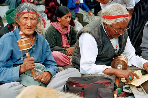 Old men with prayer wheels, Leh, Ladakh.