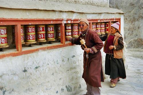 Locals ringing prayer wheels at the Lamayuru temple, Ladakh.