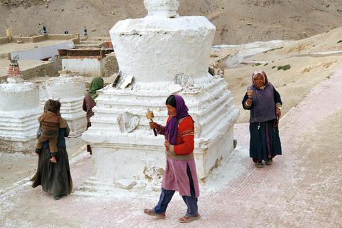Local ladies walking around a chorten at Korzok, Ladakh.