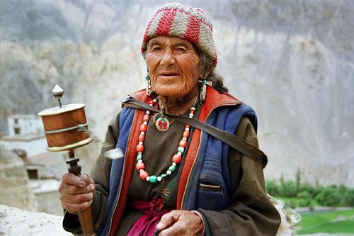 Old lady with prayer wheel at the Lamayuru Gompa, Ladakh.