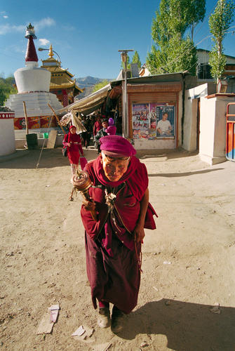 Old lady with a prayer wheel at Leh, Ladakh.