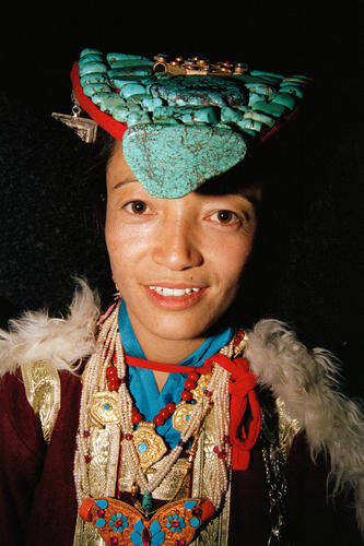 Young woman dressed in traditional Ladakhi attire at Leh, Ladakh.