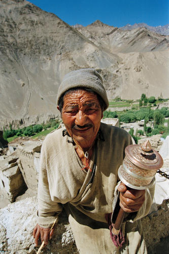 Old man with prayer wheel at the Likir temple, Ladakh.
