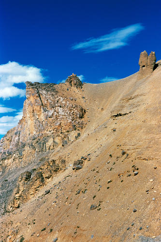 Rows of collosal wind-eroded spires dominate the landscape near the settlement of Pang, Ladakh.