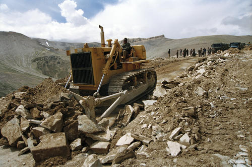 A bulldozer clearing a section of the Manali-Leh road after a landslide.