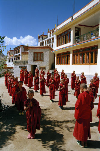 Young monks praying in the courtyard of the Likir temple.