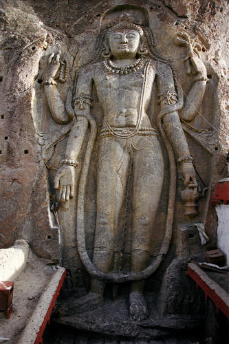 The monumental 9m/30 ft high sculpture of the Maitreya carved out of rock close to the village of Mulbekh, Ladakh.