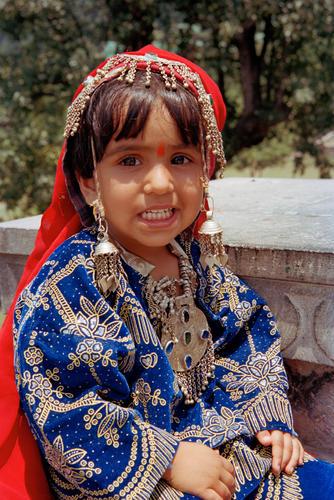 Child dressed in traditional Kashmiri attire , Pahalgam, Kashmir.