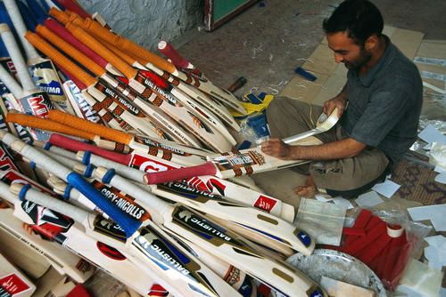 Cricket bats made in and for sale in Halmullah, Kashmir.