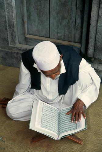 Man reading from the Koran, Srinagar, Kashmir.