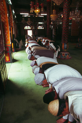 Men praying in the Dastgir Sahib Mosque, Srinagar, Kashmir.