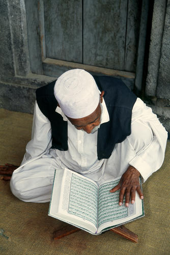 Man reading from the Koran, Srinagar, Kashmir.