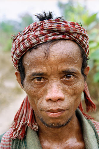 Man belonging to the Kachah indigenous people near Ban Lung, Ratanakiri Province, Cambodia.