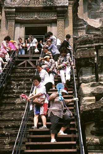 Tourists at the Angkor Wat temple complex, Siem Reap.