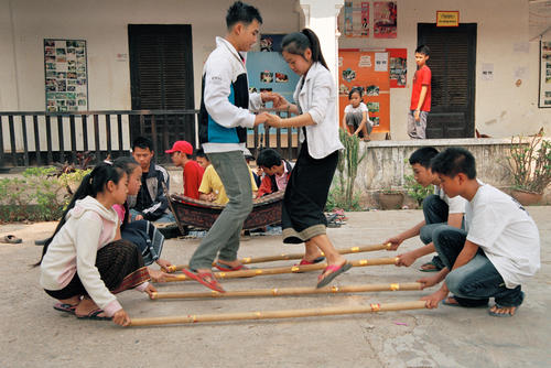 Young students performing a traditional Lao dance at Luang Prabang.