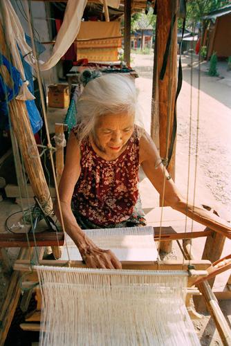 Woman weaving on a traditional Lao loom at Luang Prabang.