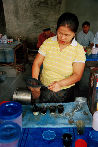 Traditional Lao coffee being served at a stall at Luang Prabang.