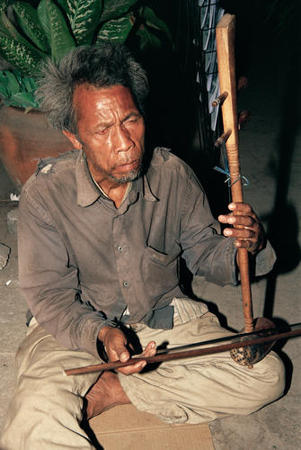 Man playing a traditional Lao zither at Luang Prabang.