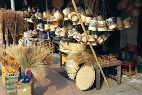Bamboo baskets and goods for sale outside a shop at Luang Prabang.
