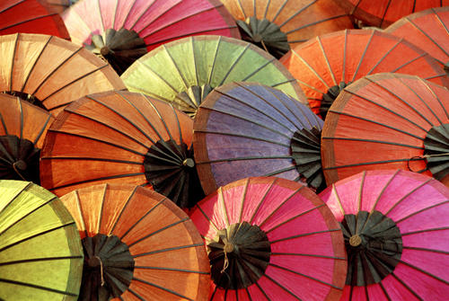 Brightly coloured handmade parasols on sale in the night market, Luang Prabang.