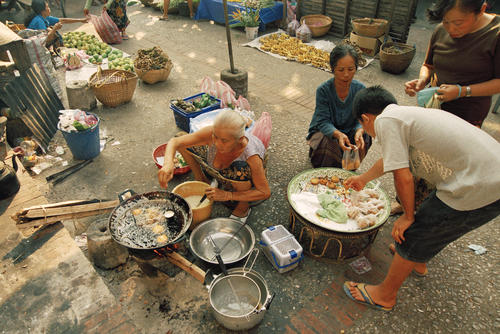 Traditional pastries being made at the morning market, Luang Prabang.