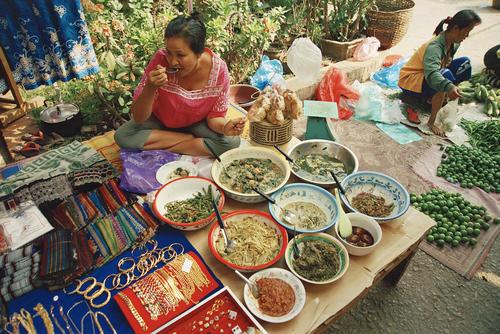 Women eating at a food stall at the morning market, Luang Prabang.