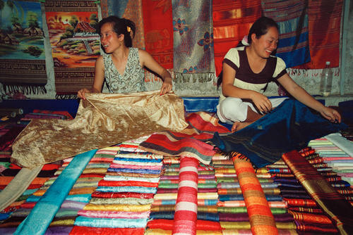 Handmade textiles made of silk on sale in the night market, Luang Prabang.