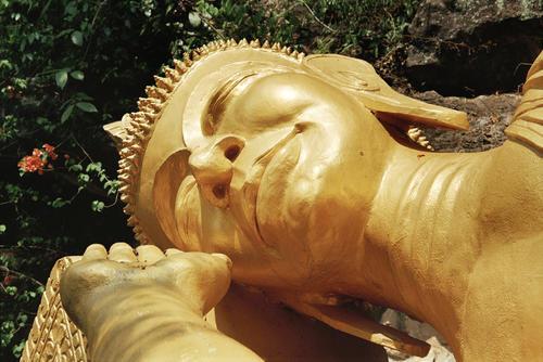 Giant reclining Buddha at Wat Thammothayalan, Mount Phousi, Luang Prabang.