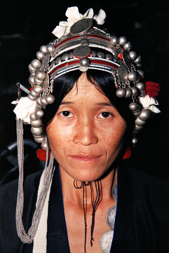 Tribal lady belonging to the Akha indigenous grouping at the market at Muang Sing, Luang Namtha Province.